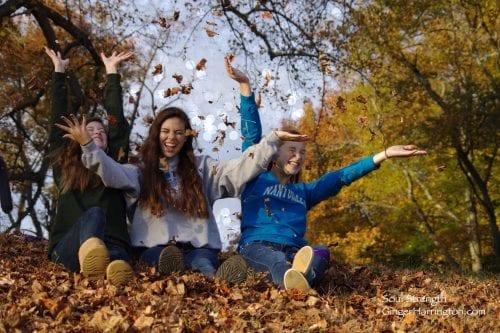 Joyful girls in leaves