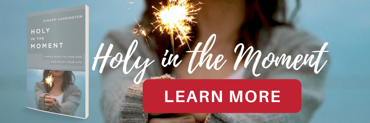 "Woman holding sparkler, book cover for Holy in the Moment, red ""Learn More"" button."